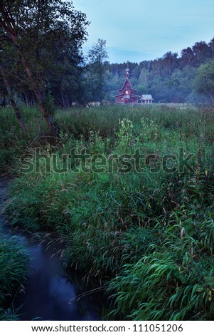 Small wooden russian orthodox church of Sergius of Radonezh on a swamp at the Springs of Gremyachii waterfall near Sergiyev Posad - stock photo