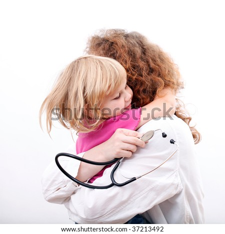 small young girl hugging woman doctor - stock photo