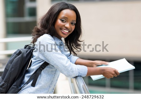 smart african american college student on campus - stock photo
