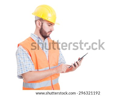Smart and modern builder or engineer using wireless  tablet - stock photo