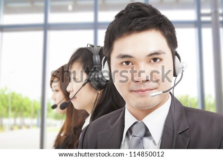 smart asian businessman with call center agent - stock photo