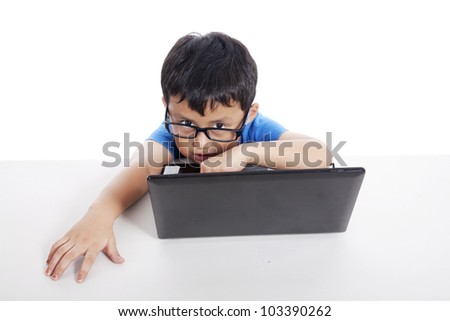 Smart asian little student with laptop shot in studio on white background - stock photo