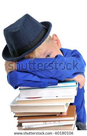 Smart Boy Cunning Look on the Pile of Books - stock photo