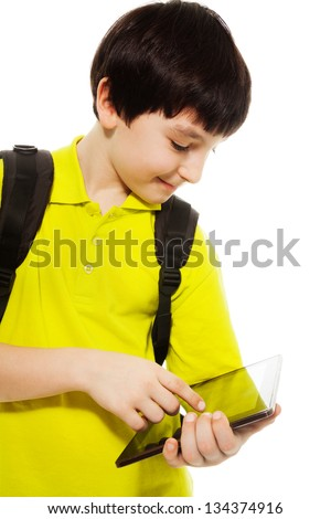 Smart boy showing new application on digital tablet computer, standing isolated on white - stock photo