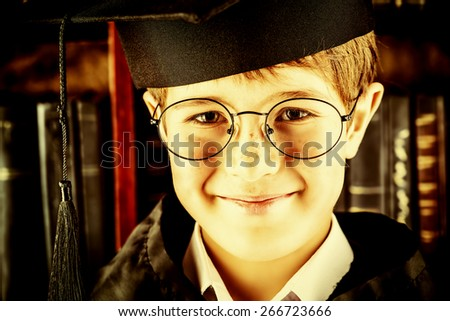 Smart boy stands in the library by the bookshelves with many old books. Educational concept. Science. Vintage style. - stock photo