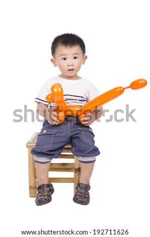 Smart boy with balloon in his hand isolated on white background - stock photo
