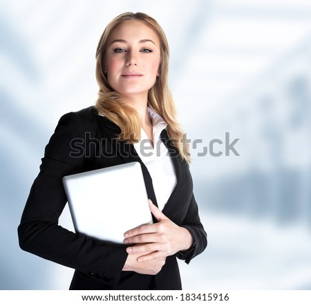 Smart business woman holding in hands laptop and standing in the office, work in great finance company, executive manager, good job concept - stock photo