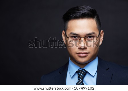 Smart businessman in formalwear looking at camera - stock photo