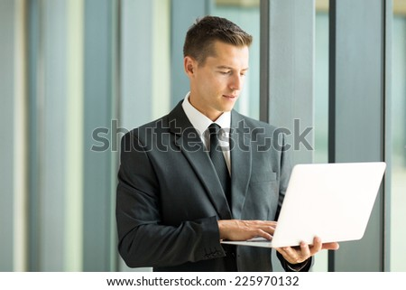 smart businessman using laptop computer - stock photo