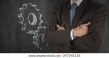 smart businessman with gear to success concept - stock photo