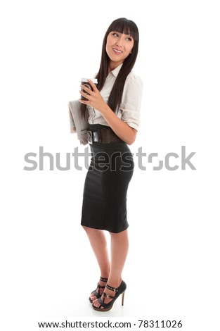 Smart businesswoman holding a takeaway coffee and financial newspaper.  She is looking over her shoulder and smiling confidently.