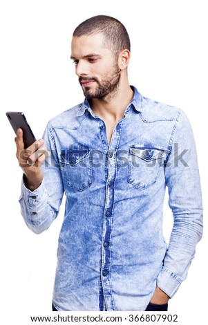Smart casual man reading a message on his smartphone, isolated on white background - stock photo