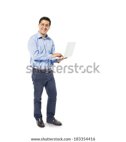 Smart Casual Middle Eastern Man Working On Laptop - stock photo