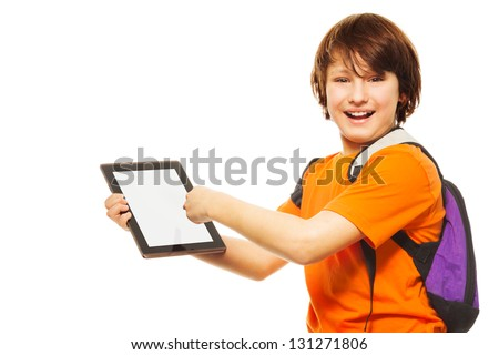 Smart Caucasian 11 years old boy showing new application on digital tablet computer, standing isolated on white - stock photo