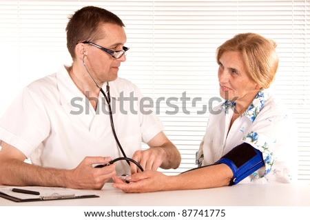 smart doctor works  with old female patient