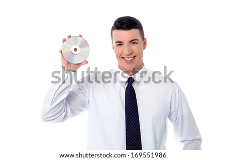 Smart executive holding a compact disc