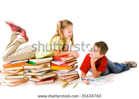Smart girl lying on top of book piles and talking to cute schoolboy drawing near by - stock photo