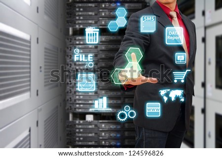 Smart hand press on icon control in data center room - stock photo