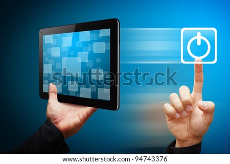 Smart hand press on power icon from tablet pc