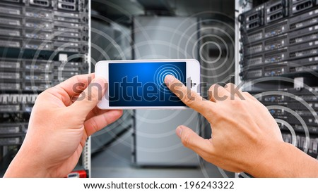 Smart hand touch on mobile phone - stock photo