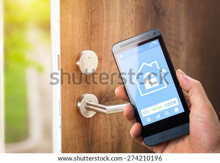 smart house, home automation, device with app icons. Man uses his smartphone with smarthome security app to unlock the door of his house.