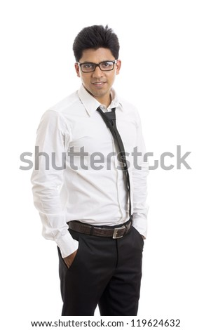 Smart Indian young businessman posing to the camera. - stock photo