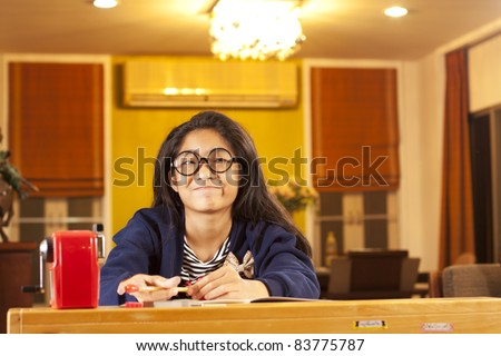 smart kid, a girl act smart on her studying lesson book. - stock photo