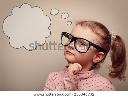 Smart kid in glasses thinking with speech bubble above with empty copy space. Vintage portrait - stock photo