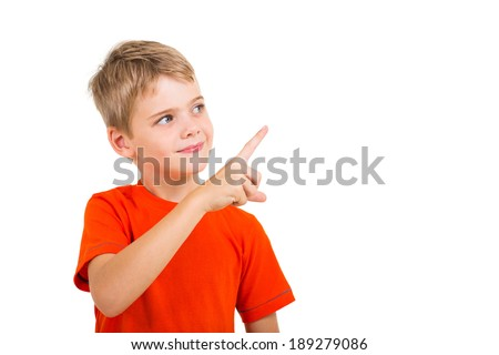 smart kid pointing at empty copy space - stock photo