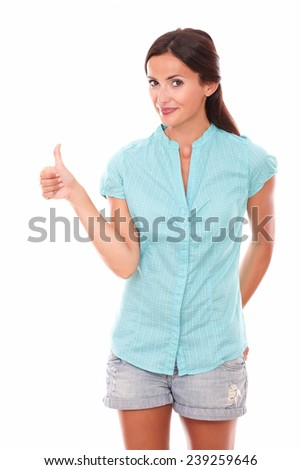 Smart lady looking at you with thumb up gesturing ok sign while standing in white background - stock photo