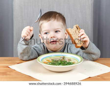 Smart little boy has dinner