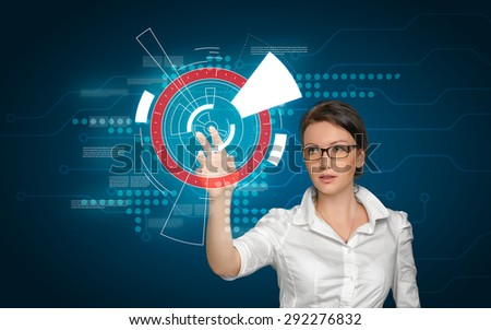 Smart-looking woman is working with digital screen on the blue phon - stock photo