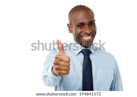 Smart male manager showing thumbs up - stock photo