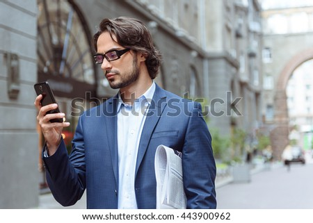 Smart man messaging on telephone
