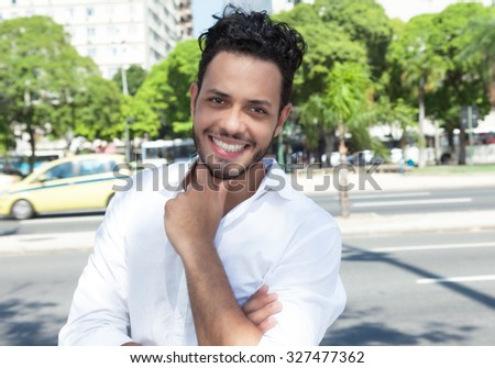 Smart man with stubble in the city - stock photo