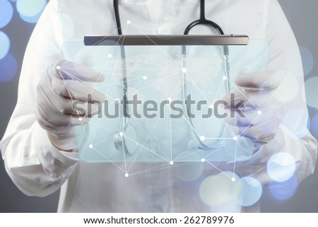 smart medical doctor hand showing network with bokeh exposure as medical network and media concept - stock photo
