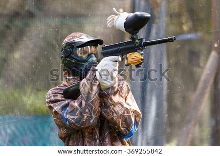 Smart paintball shooter - stock photo