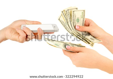 Smart phone and money on hands- pawnshop concept - stock photo
