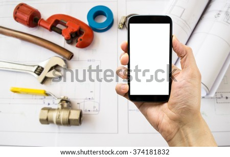 smart phone and plane installation of water and natural gas engineer table - stock photo