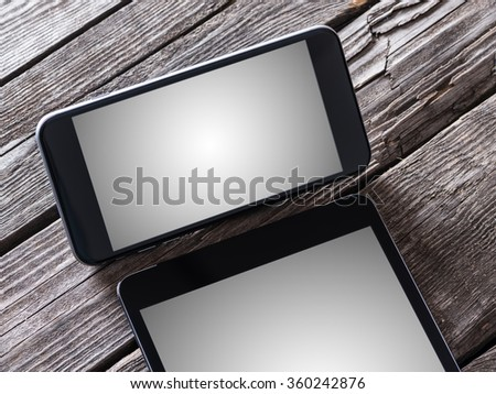 Smart phone and tablet pc on a desktop. Clipping paths included. - stock photo