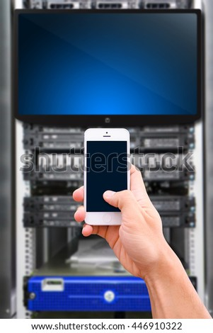Smart phone in data center room - stock photo