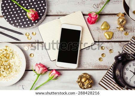 Smart phone mock up with feminine objects. View from above - stock photo