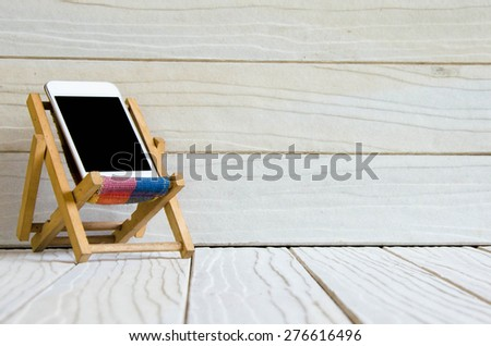 Smart phone on wooden table background with copy space - stock photo