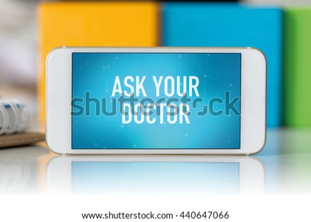 Smart phone which displaying Ask Your Doctor - stock photo