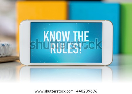 Smart phone which displaying Know The Rules! - stock photo