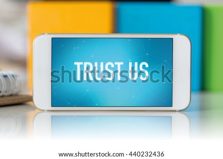 Smart phone which displaying Trust Us - stock photo