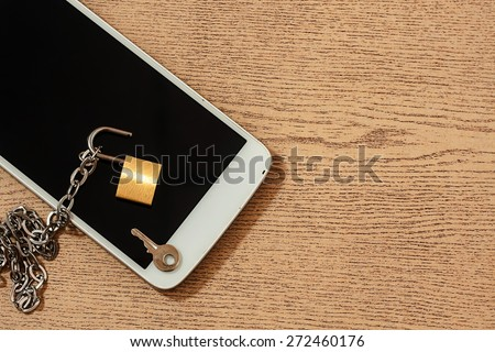 smart phone with chain lock ,black and white color tone. abstract background for solution to security smart phone form not owner. - stock photo