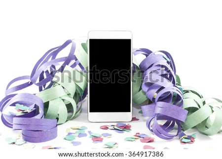 Smart phone with streamers and confetti on white background - stock photo