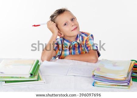Smart school boy is thinking - stock photo