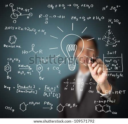smart teacher writing various high school chemistry formula with light bulb ( symbol of idea and solution ) - stock photo